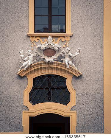 Cherubs above a church door in toledo spain