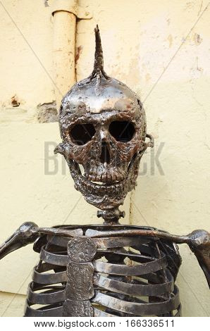 20.01.2017.Russia.Saint-Petersburg.Metal skull with a Mohawk.The skeleton stands at the entrance to the store.
