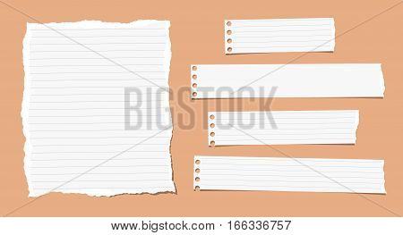 Pieces of ripped different size white note, notebook, copybook paper sheets, strips stuck on orange background.