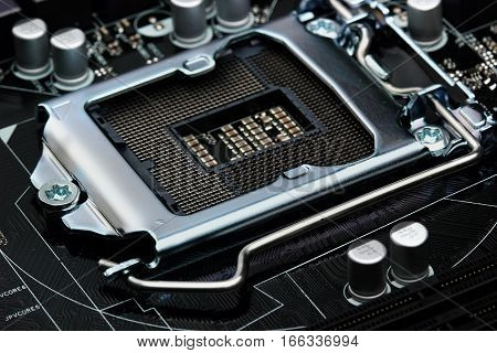 Empty Cpu Processor Socket On A Computer Motherboard With Pins Visible. Empty Cpu Processor Socket O