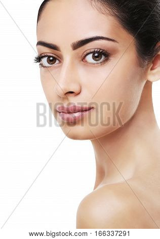 Beautiful indian girl with perfect skin make up closeup. Beauty and health care. Ideal closeup portrait of brunette, isolated on white background, copy space