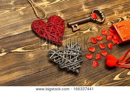 Package, Heart And Metallic Key On Wood As Valentines Decoration