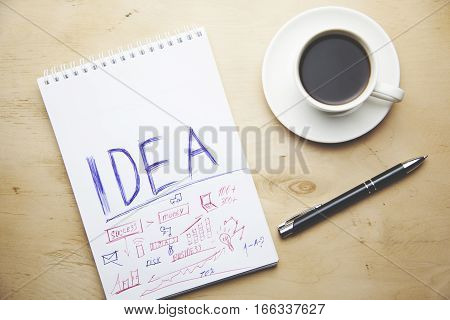 paper with coffee and notes on desk