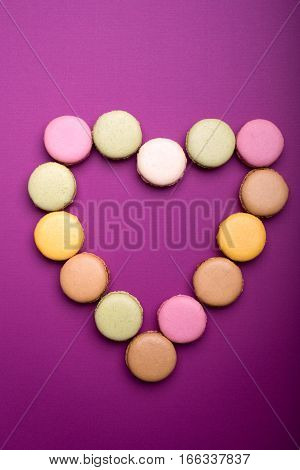Heart Shape Made Of Colorful Macaroon Or Macaron Dessert On Lilac Background