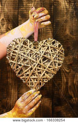 Female Hand Holding Heart