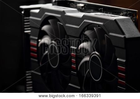 video card with two coolers from the computer on a dark background.concept computer harware.selective focus
