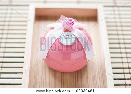 Pink Gift Boxes In Round Shape On Wooden Mat Background. Valentine Background.