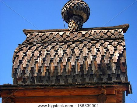The roof of the chapel in Siberian village. Closeup. Ethnographic Open-Air Museum