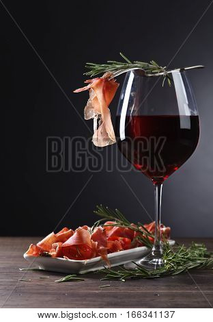Prosciutto With  Rosemary And Glass Of Red Wine