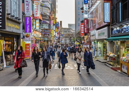 MYEONG-DONG SEOUL KOREA: APRIL 12016: People shopping and walking in Myeongdong street market Seoul South Korea