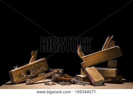 Wooden carpenter tools background isolated on black