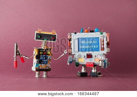 Welcome to industry 4.0 concept. IT specialist robot serviceman with pliers looking at colorful computer. Welcome to the new economic future message on blue display. Violet background, macro view