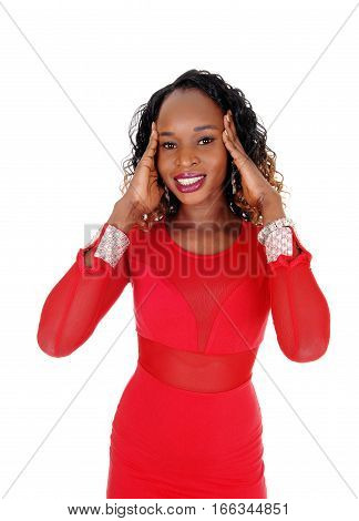 Beautiful young African American woman standing waist up in red dress with her hands on her head for pain isolated for white background.
