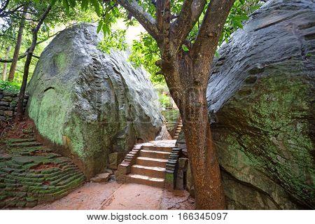 Stairs cut in rock in Sigiriya ruin archaeological site