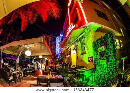 People Enjoy The Bar And Restaurant At Night At Ocean Drive  In South Beach, Miami In The Art Deco D