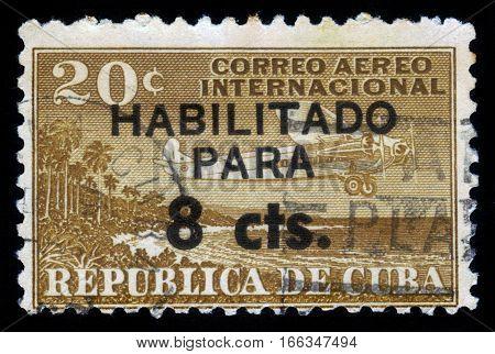 CUBA, CIRCA 1961: stamp printed in Cuba , shows aircraft over coast of Cuba, circa 1961