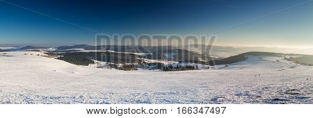 Panorama of the Rhoen in winter as seen from the top of the Wasserkuppe Hesse Germany