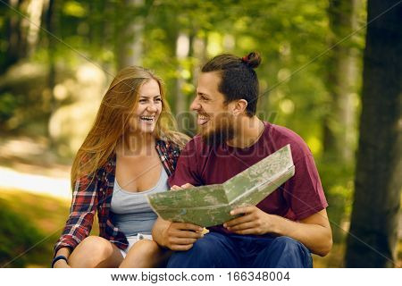 Traveling couple faving fun in the forest