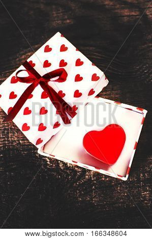 Gigt box with hearts and red ribbon. Holidays background concept. Valentines day background
