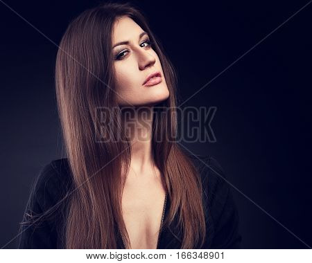 Expressive Model Posing In Black Jacket With Long Straight Hair Style And Long Neck On Dark Backgrou