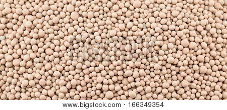 Composite mineral fertilizers balls for plants. Background