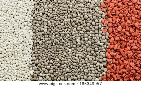 Composite mineral fertilizers for plants closeup. Background