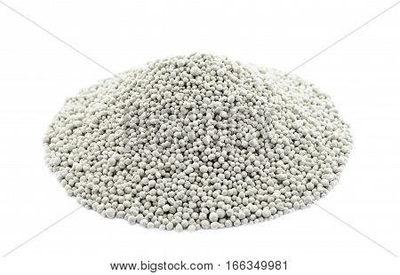 Heap of comopsite mineral fertilizers isolated on the white background