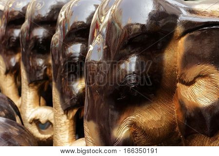 Glossy Shiny Prayed Elephant Statues Brown and Golden Colors