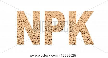 NPK letters made of composite mineral fertilizers on the white background. N - nitrogen P - phosphorus K - potassium (kalium). Selective focus