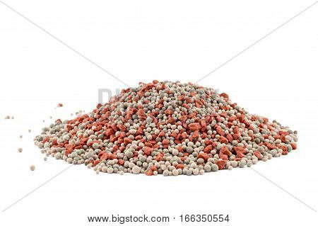 Heap of composite mineral fertilizers isolated on the white background