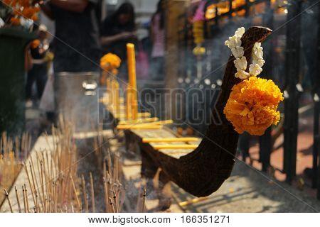 Yellow Prayed Flower and burning joss sticks