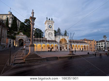 The Loggia of St. Giovanni with the clock tower in Square of freedom in Udine. Italy.