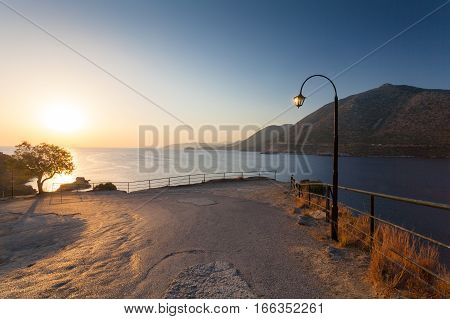 Morning landscape with lamp near viewpoint mountains and sea. Village Bali island Crete Greece.