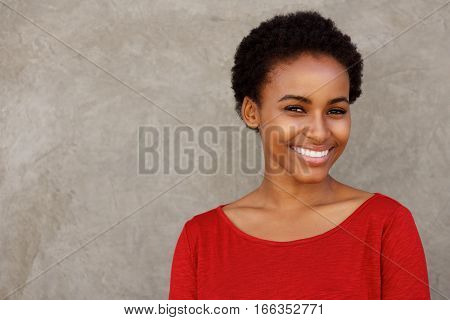 Attractive Young Black Woman In Red Shirt Smiling