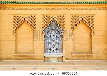 Moroccan Style Fountain With Fine Colorful Mosaic Tiles At The Mohammed V Mausoluem In Rabat