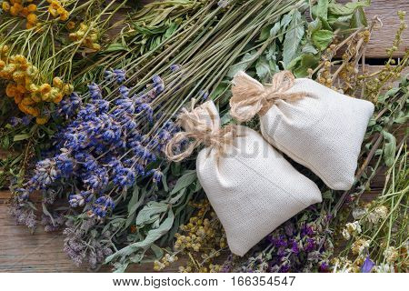 Bunch Of Healing Herbs And Sachet On Wooden Table. Top View, Flat Lay.