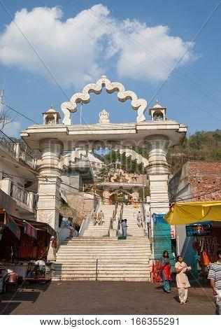 JWALAMUKHI, INDIA. June 3, 2009:  Pilgrims at the great white gates in the Devi Temple. Jawalamukhi, Kangra district, Himachal Pradesh, India.