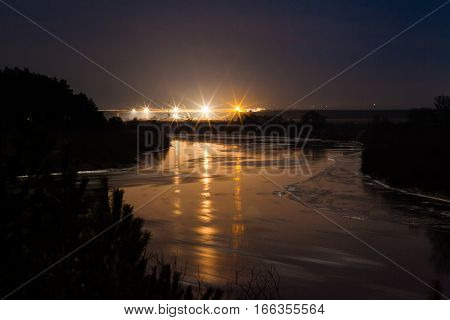 Floating on the river ice in moonlit winter night