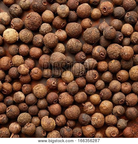 Texture of the allspice. Pepper spice background