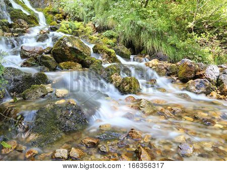 Mountain Stream With Water That Seems In Motion Photographed Wit