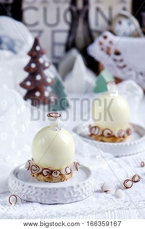 Cake Coconut ball with coconut ganache and passion fruit marmalade