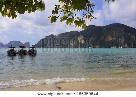 beautiful marine landscape view of long tail boats on the beach at koh phi phi island in Thailand in Krabi province South Asia in holiday and vacation travel and tourist destination concept