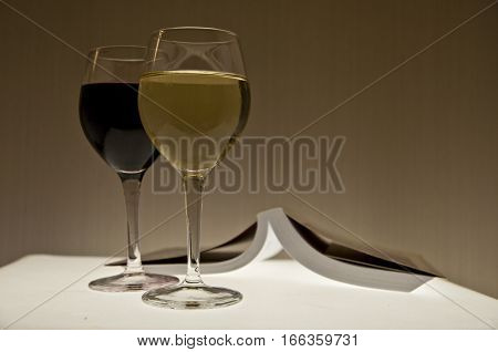 Book and two wine glasses - relaxing evening concept