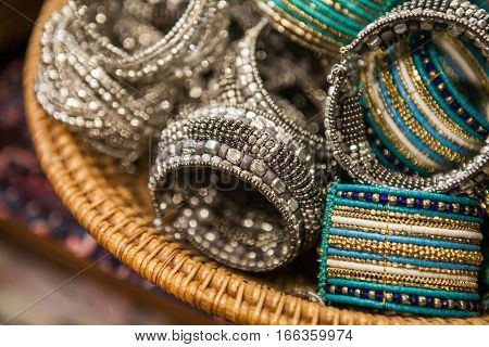 Set of beautiful traditional indian bracelets on a market. Authentic jewelry