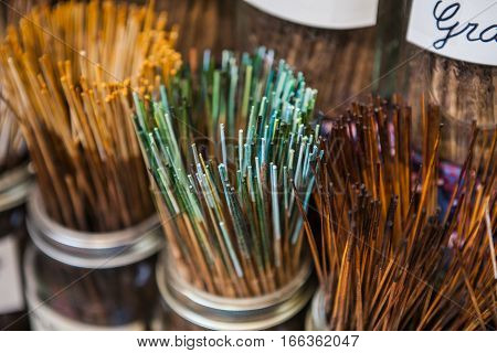Assortiment of incense aromatic sticks in store.