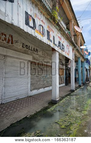 June 9, 2016 Colon, Panama: sewage sludge flowing freely on the street of the tropical port town