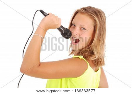 Happy young beautiful girl singing with microphone isolated on white background