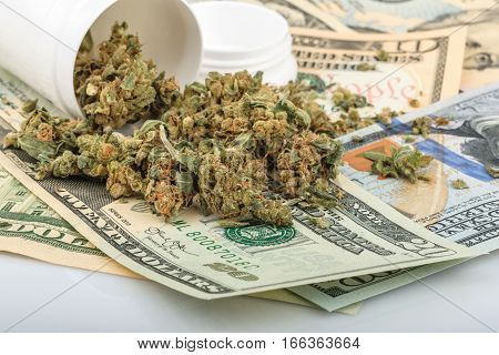 Marijuana and money on white. close up