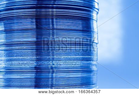 A column of DVDs in close up view with blue color