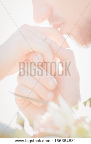 groom kisses the hand of the bride. fine art wedding photography